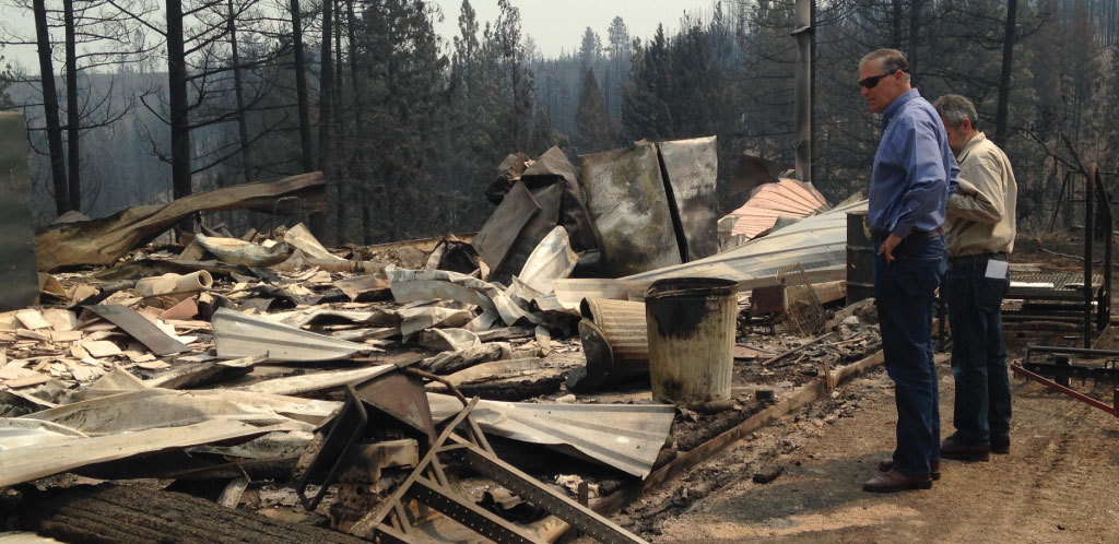 Gov. Inslee and a home destroyed by wildfire in Okanogan County